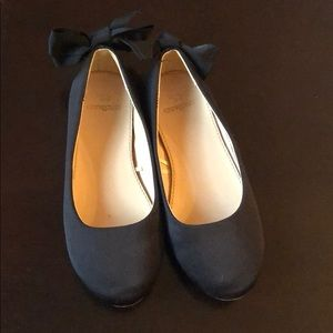 Black satin ballet shoes with grosgrain bow